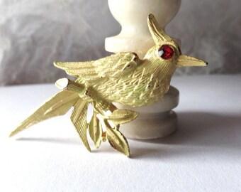 Vintage golden bird brooch with ruby rhinestone eye, 2 inch pin brooch, July birthstone, wedding bouquet, shrug shawl purse pin, wild bird