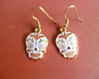 White or black enameled skull earrings for Day of the Dead or Halloween.