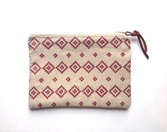 pouch with brass zipper in red geo diamond folk pattern