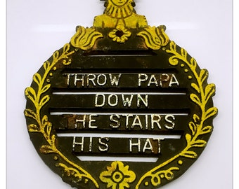 Vintage Cast Iron Amish Man Trivet Throw Papa Down the Stairs His Hat