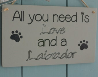All you need is love and a dog.  Any breed, novelty dog lover plaque.