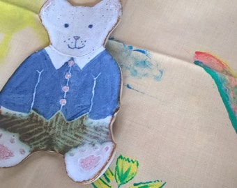 Teddy bear spoon rest - hand made ceramic. He is so appealing in his little blue jacket!
