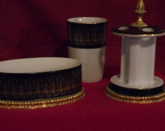 Three piece bathroom set.  Cup, Toothbrush holder, soap dish.