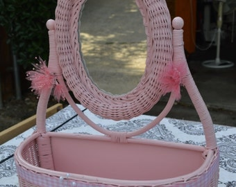Pink wicker mirror