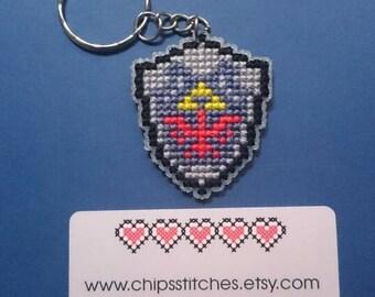 Zelda inspired Hylian Shield double sided cross stitch keychain