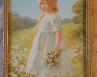 Vintage framed print of girl in a field of daisies