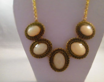 Bib Necklace with Gold Tone and White Pendants on a Gold Tone Chain
