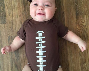 Football stitches Baby bodysuit . Football Baby, sports fan baby shirt, new baby, baby shower gift, infant, football fan, baby clothes.