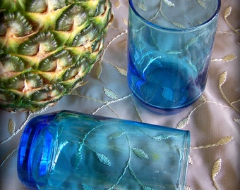 Two aqua colored bar glasses Ocean blue cocktail glasses Aqua glass Tappered base 4 inch tall juice glass Set of two blue drinking glasses