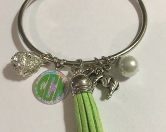 Totally custom, preppy tassel charm bracelet!  Show your girly side with fun and flirty charms! Start with lilly monogram charm and tassel.
