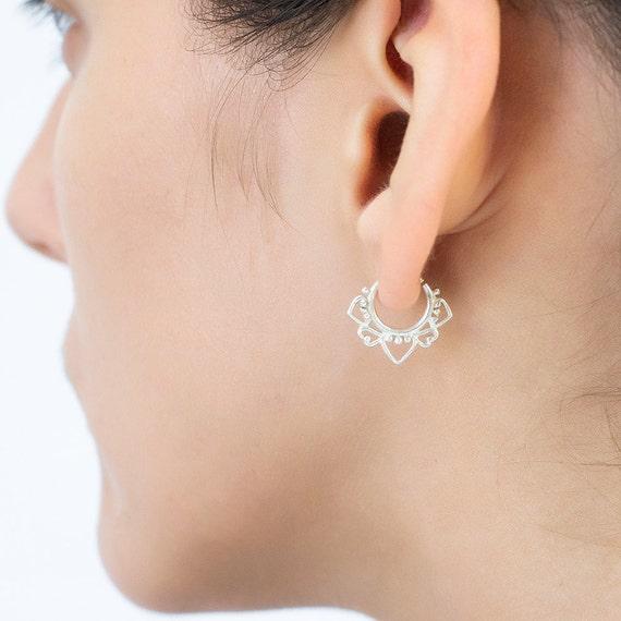 Tribal earring. tiny earrings. helix earring. tragus piercing. cartilage earring. tragus earring. tragus hoops. tiny hoops. tribal.