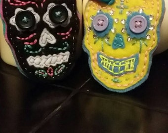 Hand stitched felt Dia de Los Muertos/ Day of the Dead sugar skull brooches. Also made to order.