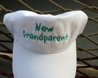 """New Grandparent - White Cap with Aqua Marine Lettering- """"It's a Girl"""" on the Back"""