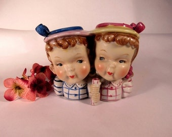 Vintage 1950's Two Little Girls Children  Head Vase. The Little Girls are as Cute as can be with their Pigtails and Bonnets!