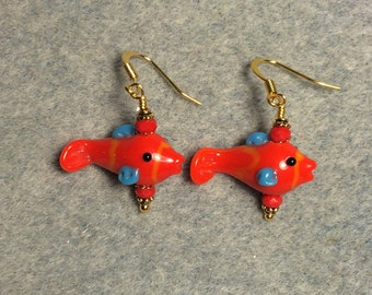 Red and blue lampwork fish bead earrings adorned with red Chinese crystal beads.