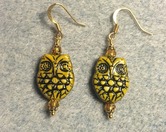 Topaz with black wash Czech glass owl bead earrings adorned with topaz Chinese crystal beads.
