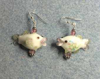 White and pink lampwork fish bead earrings adorned with pink Czech glass beads.