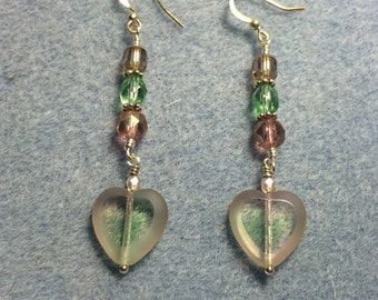 Light green and light pink Czech glass heart bead dangle earrings adorned with light green and light pink Czech glass beads.