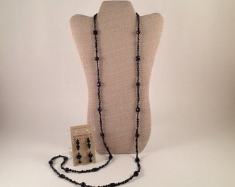 delicate , long onyx strand necklace and earrings.