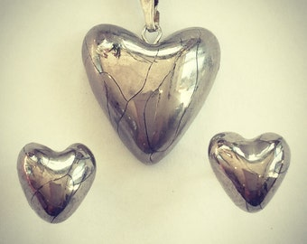 Silver heart pendant with heart studs.
