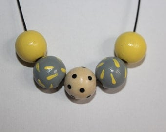 Spots and stripes hand painted wooden bead necklace.