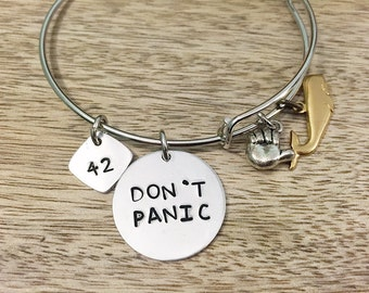The Hitchhiker's Guide to the Galaxy inspired bangle bracelet.  Flaunt your fandom!