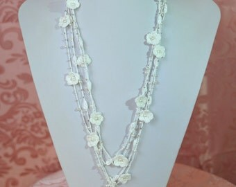 Crochet wedding necklace with flowers Balan with pearls and beads of light