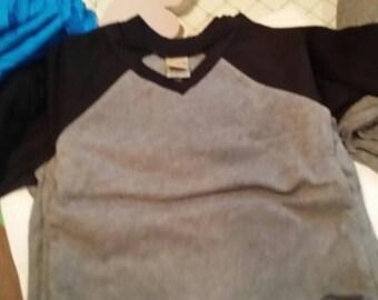 Toddler infant size raglan shirt.