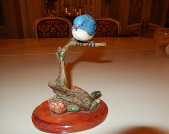 BIRD FIGURINE on BRANCH