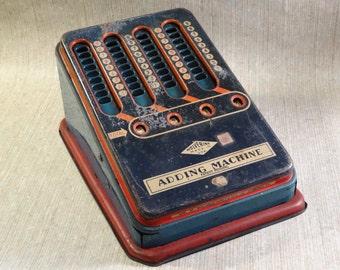 1940s Wolverine Tin Adding Machine