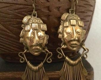 Vintage earrings of mayan head in golden color