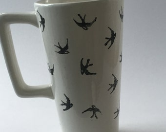 Ceramic travel mug hand decorated with black birds (swallows)