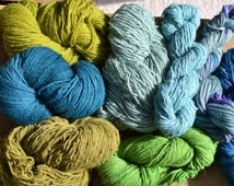 Beautiful batch of colors! Worsted weight rug yarn, 2 pounds 4.8 ounces, approximately 1,314 yards.