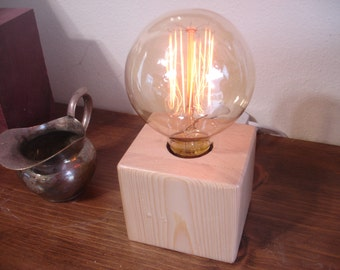 Stacked knotty pine table lamp. Oversized Edison style Victorian bulb. IN -LINE DIMMER switch.