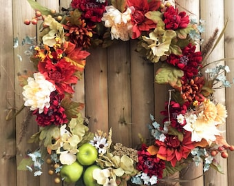 Fall floral wreath with apples