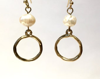 Gold circle and pearl earrings