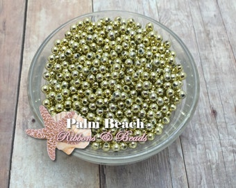 Approximately 200 4mm Spacer Beads Gold