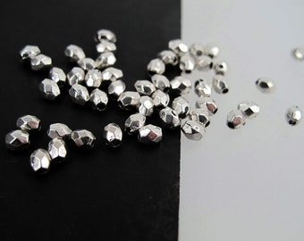 Small silver metal beads. Facet metal nugget beads. 50 beads