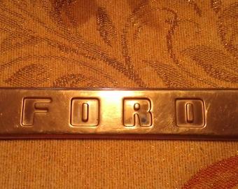 50's Ford truck Emblem RH