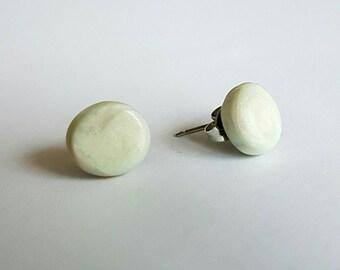Pearl clay stud earrings.