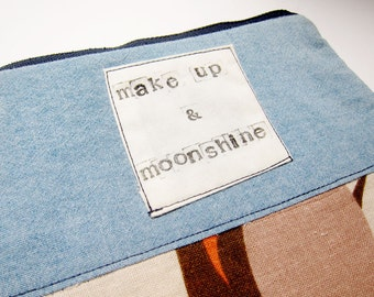 Makeup & Moonshine small trapezoid pouch eco conscious funny makeup bag upcycled tropical print denim color block stamped stocking stuffer