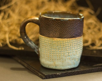 Hand-crafted mug with textures and light blue textured glaze