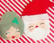 Kitsch vintage Santa and Mrs Claus ornament with peppermint gift box.