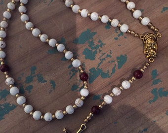 white wine and gold rosary
