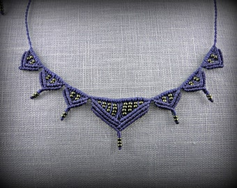 Navy blue macrame necklace adorned with green beads