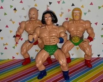 Vintage 1980s WWF Hulk Hogan, Iron Sheik, and Andre the Giant Bootleg Wrestling Figures