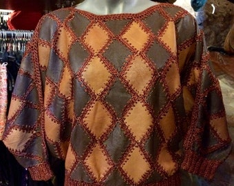 1980's dropped shoulder, bat-sleeves, patchwork, crocheted leather sweater. Size S.