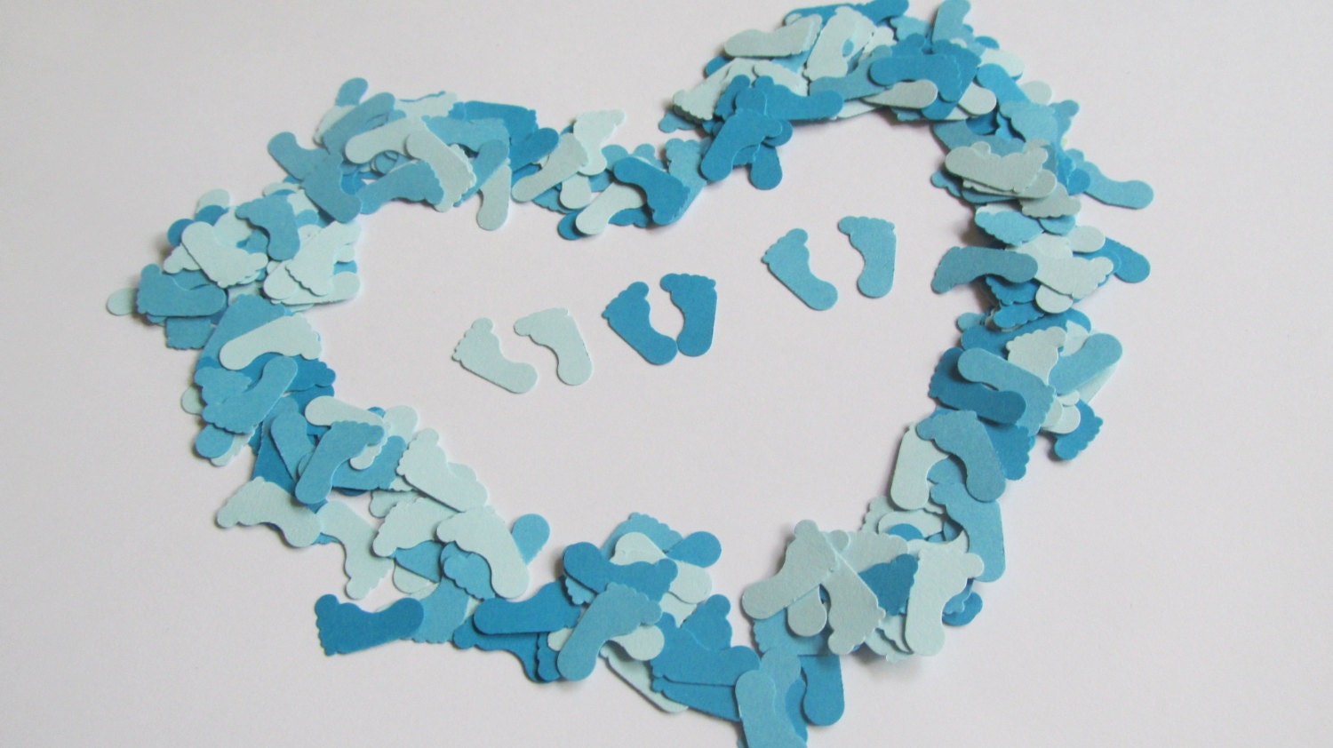 baby feet confetti in blue baby shower confetti baby shower