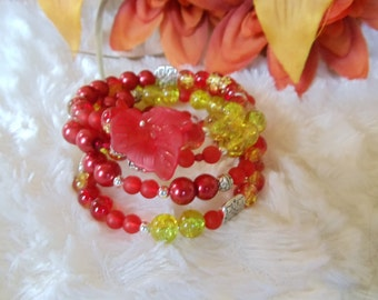 Statement spiral bracelet with red/yellow Crackle glass beads