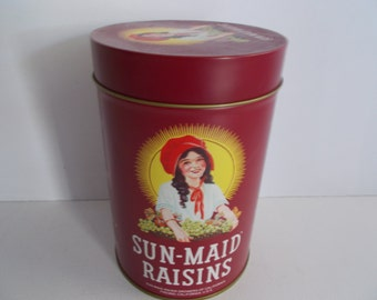 1987 Sun-Maid Raisins Tin, Apron, and Book